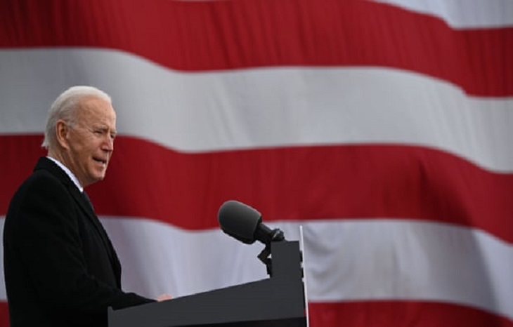 Biden returns US to Paris climate accord hours after becoming president